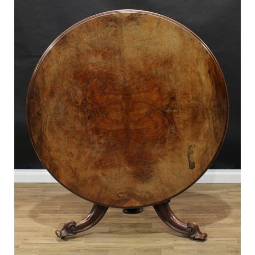 16 - A Victorian walnut circular centre table, moulded top, fluted baluster pillar, cabriole legs carved ...