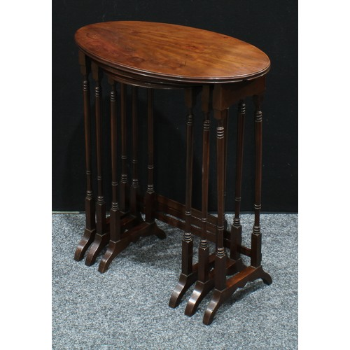 10A - A George III Revival mahogany nest of three oval occasional tables, moulded edge, turned legs, c.192...
