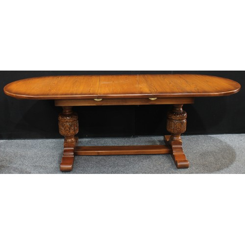 15A - An 18th century style oak extending refectory type trestle dining table, possibly by Mellowcraft, di...
