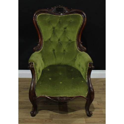 7 - A Victorian mahogany drawing room chair, shaped cresting rail pierced and carved with acanthus and C...