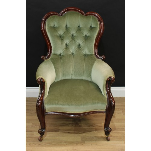 1144 - A Victorian mahogany drawing room armchair, 'trefid' back, acanthus scroll arms, deep button stuffed...