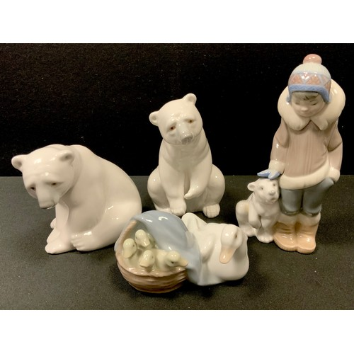 18 - Lladro including Young Inuit Boy with Polar Bear Cub, two seated Polar Bears; a Basket of Chicks (4)...
