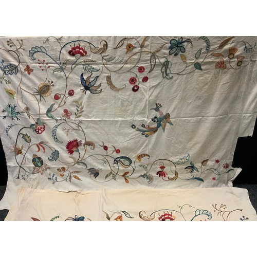 21 - Textiles - a pair of hand crafted rectangular embroidered tapestry panels, each with a stylized Phea...