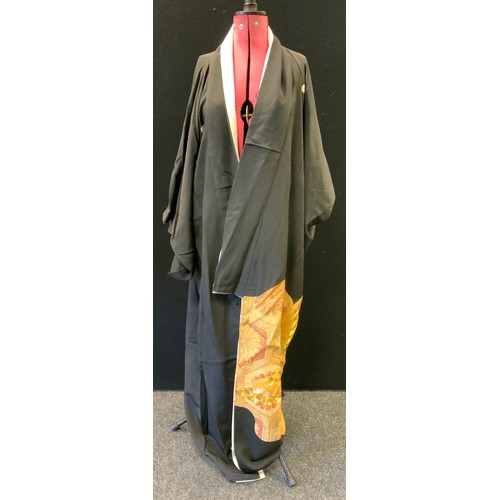 41 - A Japanese black and multi coloured kimono with black top and sleeves above gilt and russet floral a...