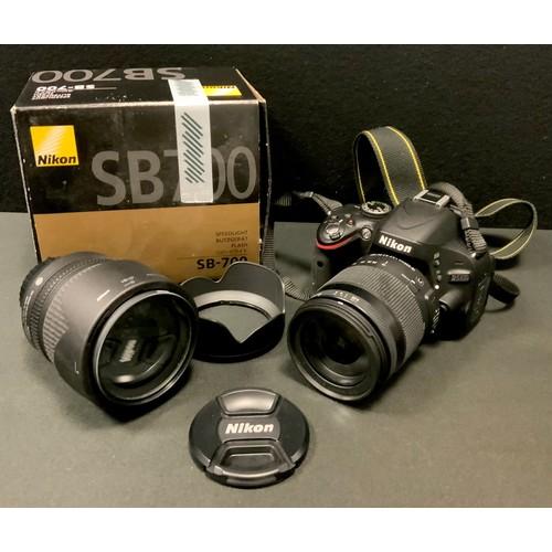 57 - A Nikon D5100 camera, Sigma 18-200mm 1:3.5 lens; a Nikon DX AF-S 18-105mm 1:3.5 lens; Nikon SB-700 A...