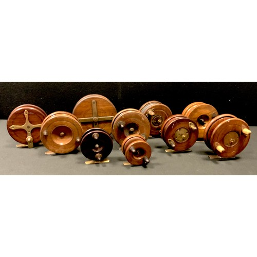 22 - Various early 20th century wood and brass reels including D. Slater, A.W Gamage, S. Allcock & Co. Lt...
