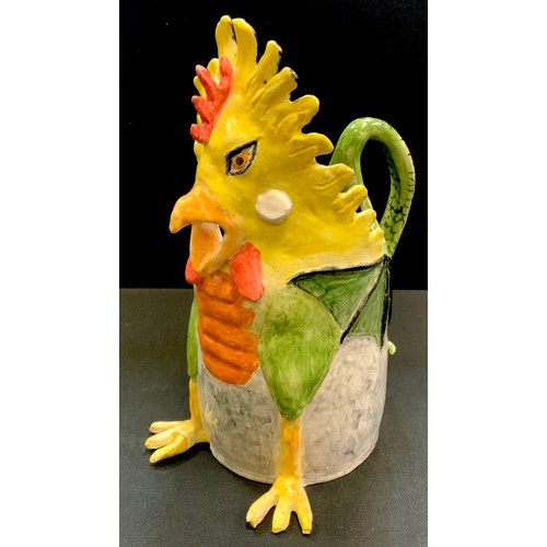 3 - A Prue Piper (b.1938) novelty jug in the form of a ferocious cockerel a winged dragons body the tail...