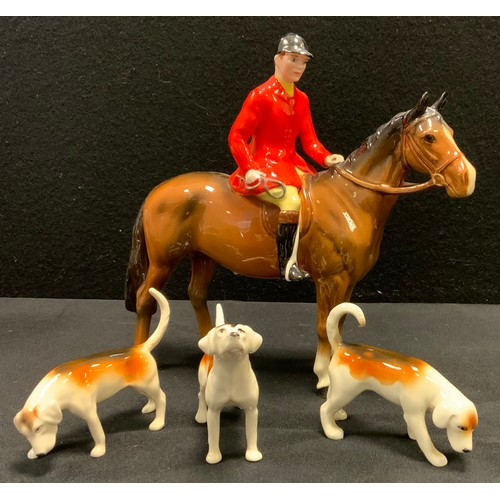 5 - A Beswick model Huntsman, brown gloss, three assorted hounds  (4)...