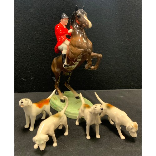 8 - A Beswick model Rearing Huntsman, model 868, four assorted hounds (5)...