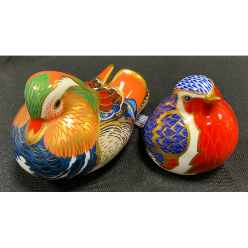 10 - A Royal Crown Derby Mandarin Duck paperweight;  another Robin, both gold stopper (2)...