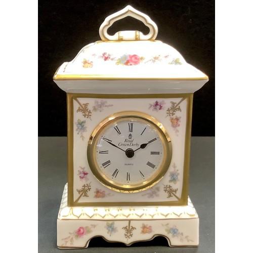 11 - A Royal Crown Derby Royal Antoinette porcelain mantel clock, with floral decoration and gilding, box...
