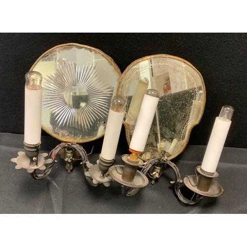 25 - An early 20th century two branch girandole wall light, skull shaped mirror reflector back, 28.5cm x ...