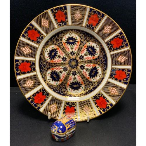 27 - A Royal Crown Derby 1128 imari dinner plate, 26.5cm diameter, 1st; a Millennium Bug paperweight, gol...