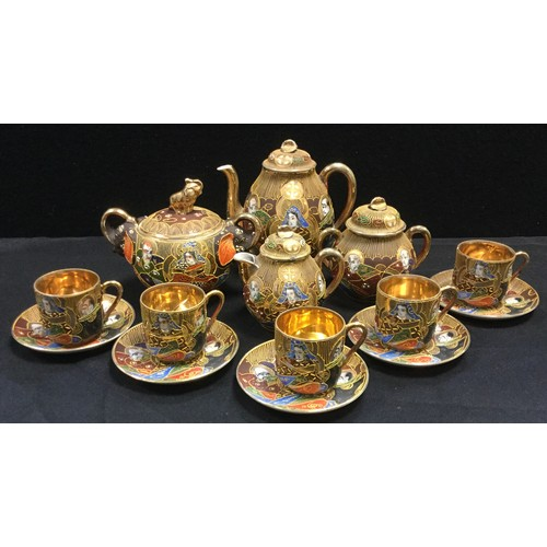 31 - A Japanese Satsuma exportware coffee set decorated with traditional deities and figure, etc qty...