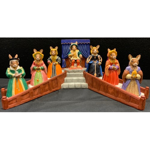 33 - A Royal Doulton Bunnykins Tudor Collection Henry VIII and his wives set on display stand, inc Anne B...