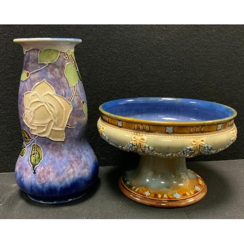35 - A Royal Doulton stoneware vase tubelined with flowers, impressed marks; similar fruit bowl comport (...