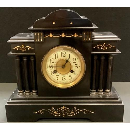 43 - A Victorian  Belge Noir mantel clock, Junghans movement, architectural pediment, enamelled chapter r...