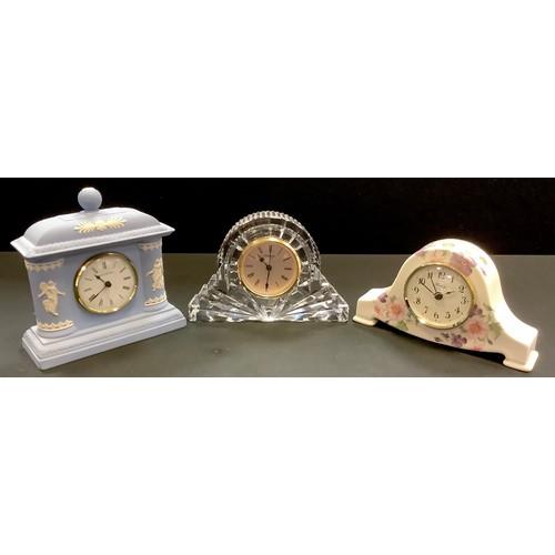 49 - A Waterford Crystal mantel clock; a Wedgwood Jasperware mantel clock; a Blandford ceramic mantel clo...