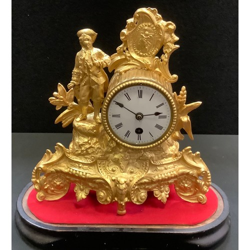 54 - A gilt metal figural mantel clock under a glass dome, man with tricorn hat stands to one side, ename...