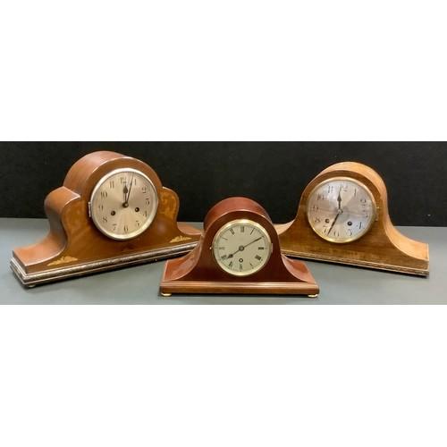 67 - An Edwardian mahogany mantel clock by W.H.May, Nottingham; another, foliage inlay; an oak mantel clo...