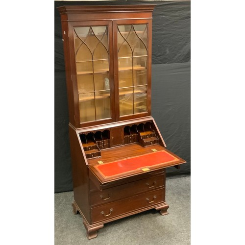 79 - A mahogany bureau bookcase, outswept cornice above a pair of astragal doors enclosing three adjustab...