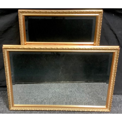 80 - A pair of gilt wood framed rectangular wall mirrors. 58.5cm x 83.5cm overall.