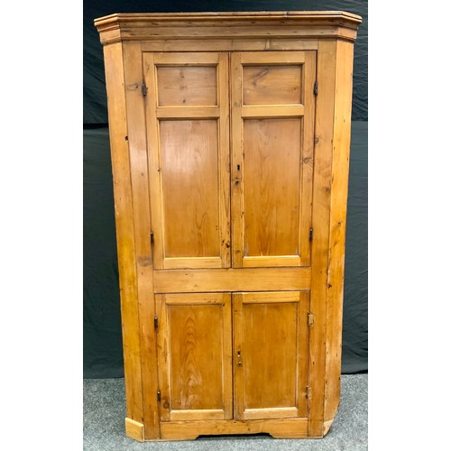 88 - A Victorian pine floor standing corner cupboard, two long over two short panelled doors, 190cm high,...