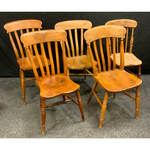 100 - A near set of four beech and elm kitchen  chairs, lath backs, saddle seat, H-stretchers, turned legs...