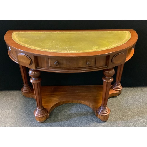 126 - A Victorian style demi lune side table desk, leather inset top, single frieze drawer, turned and ree...