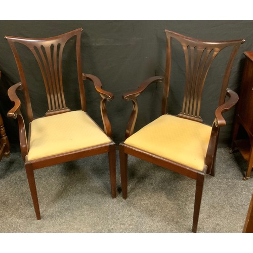 127 - A pair of early 20th century mahogany carvers, outswept arms, drop-in seats, tapered square legs, 10...