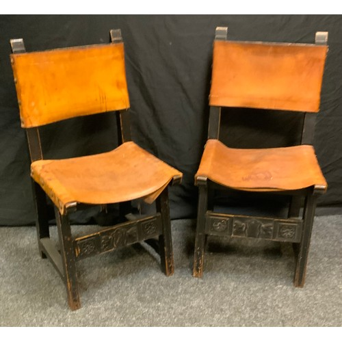 172 - A pair of 20th century chairs, leather strap backs and seats.(2)