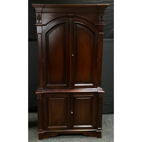 181 - A reproduction mahogany TV cabinet in the form of a linen press. 202cm high x 105cm wide x 72cm deep