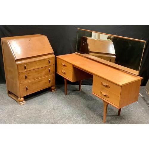 183 - A retro teak Austin suite dressing table and a 1940's bureau. (2)