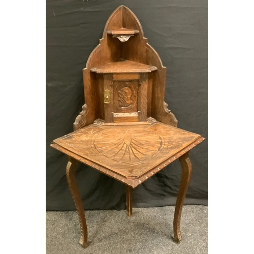 185 - A 17th century style oak credence corner display unit, carved throughout, 134cm high