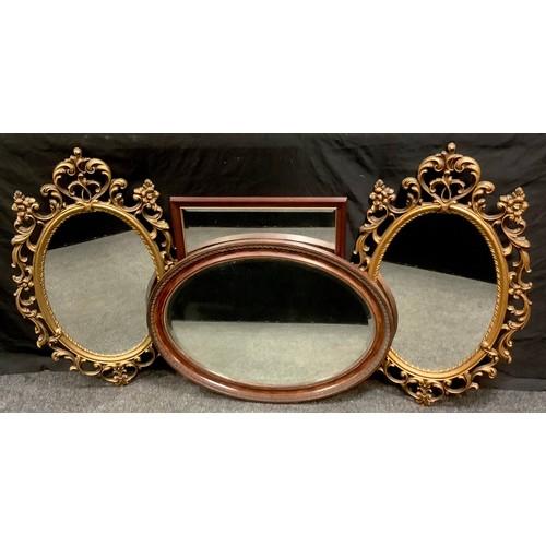 186 - An Edwardian oval wall mirror, a modern rectangular wall mirror, a pair of modern gilt framed oval w...