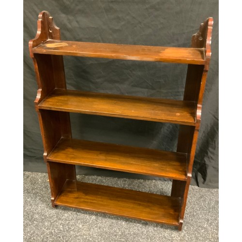 192 - A late Victorian mahogany wall mounting book shelf, four open backed shelves, shaped sides and top, ...