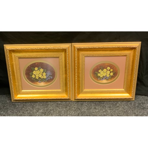 208 - Marie Graves, a pair, oval yellow and blue primulas, signed, watercolour, 15.5cm x 20cm