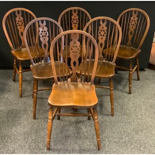 221 - A set of six modern wheel back dining/side chairs, saddle seats, H-stretcher, turned legs,(6)