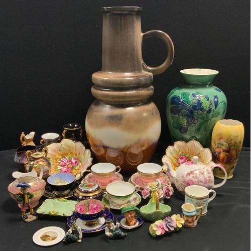 240 - Ceramics - an Aynsley Cabbage Rose C1031 teacup signed JA Bailey and saucer, cobalt blue exterior, a...