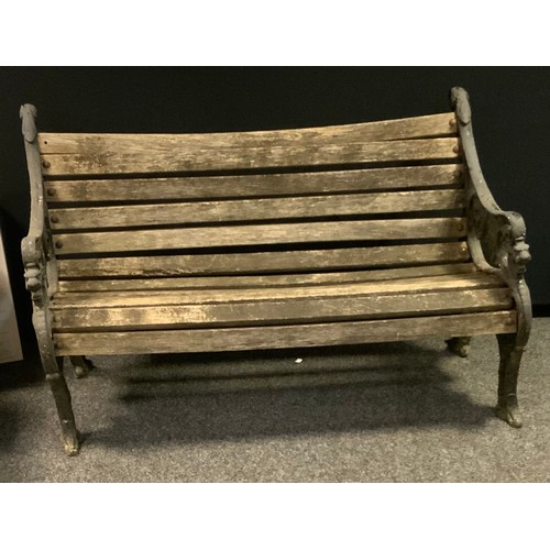 247 - A cast iron wooden slatted garden bench.