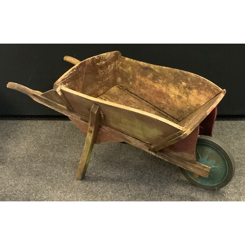249 - A 20th century wooden wheelbarrow.
