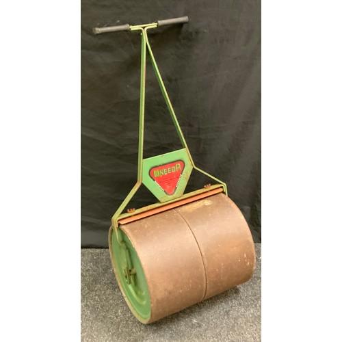 256 - A vintage Uneeda cast iron garden lawn roller, 99cm high, 45cm wide.
