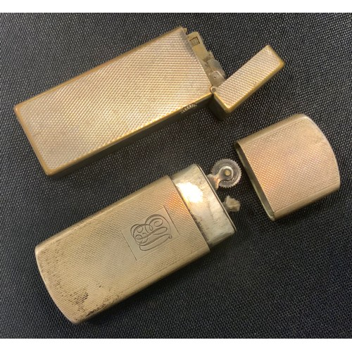 269 - Tobaccania - a vintage Swiss Dunhill silver plated pocket lighter, marked US. RE24153 patented;  a s...