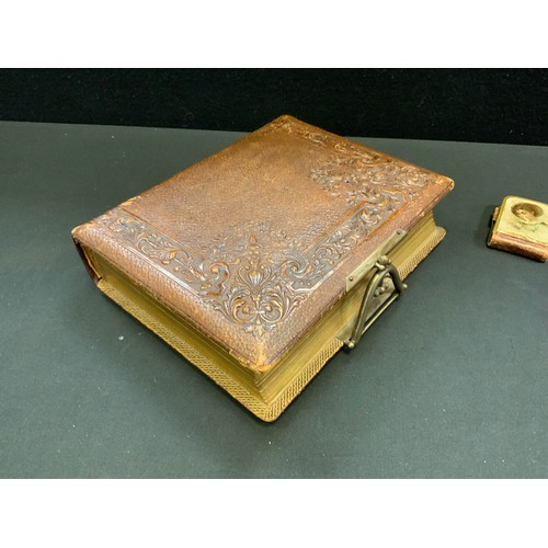 276 - A Victorian leather bound photograph album, embossed decoration, brass fitting; various early 20th c...