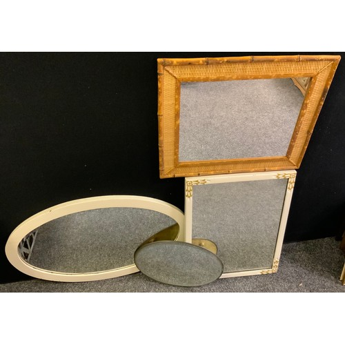 165 - A modern wall hanging looking glass, bevelled oval mirror, 67cm wide; other various mirrors.(4)