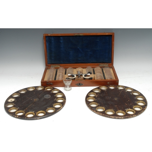 3783 - Medical - Optometry, am early 20th century mahogany optometrist's case, hinged cover enclosing an ar...