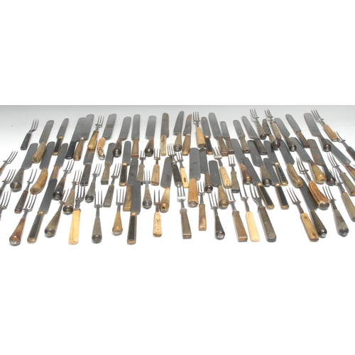 3168 - A collection of early 19th century and later flatware, comprising George IV horn hafted knives and f...