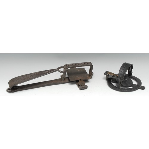 3094 - A 19th century wrought iron circular gin trap, by H Lane, 13.5cm diam; another, rectangular jaws, in...