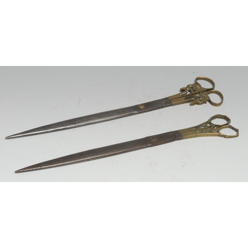 3333 - A pair of Middle Eastern Islamic steel and brass calligraphy scissors, the blades with traces of dec...