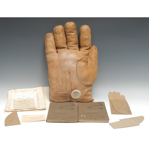 3439 - Advertising - an early 20th century promotional shop window display, as an oversize leather glove, t...